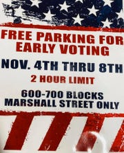 Pictured is the signage that is attached to parking spots that are designated as free parking.