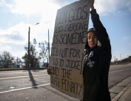 """Francine Primeaux protests the death penalty before Charles Rhines' execution on Monday, Nov. 4, 2019 at the South Dakota State Penitentiary. Primeaux's brother, Roscoe Primeaux, is serving a life sentence for second-degree murder. Her son is serving time for aggravated assault. """"It's not for us to judge,"""" Primeaux said. """"I think it's inhumane. I think it's cruel."""""""