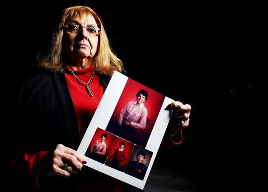 Peggy Schaeffer, of Black Hawk, S.D., stands for a portrait while holding a photograph of her son, Donnivan Schaeffer, in 2014.
