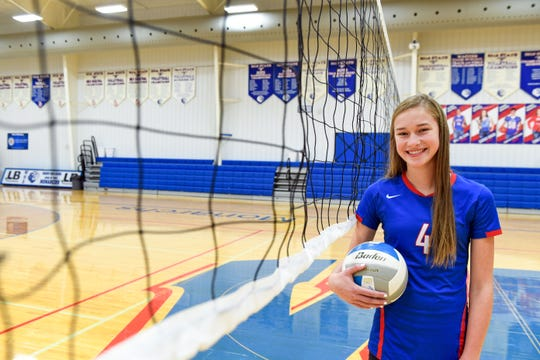 Ava Nilsson stands for portraits in the Warner High School gymnasium on Thursday, October 31. Nilsson, who is in eighth grade, plays as starting setter on the high school's volleyball team.