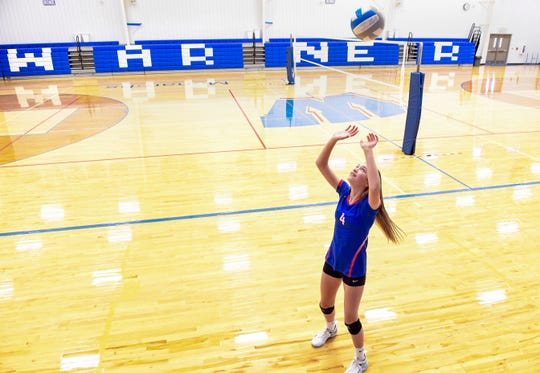 Ava Nilsson practices setting to herself in the Warner High School gymnasium on Thursday, October 31. Nilsson, who is in eighth grade, plays as starting setter on the high school's volleyball team.