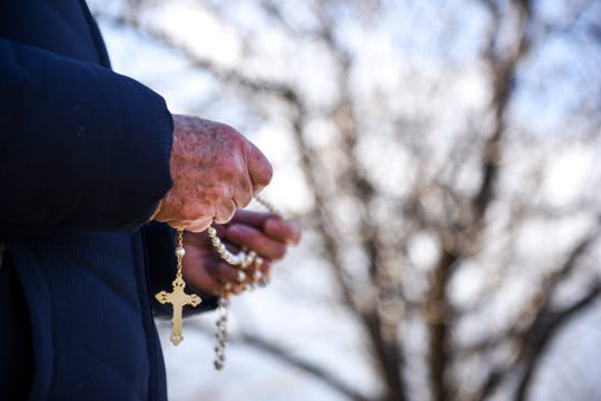 Susan Thompson with Pax Christi of Brookings, S.D., holds rosary beads as she prays during a prayer vigil for the execution of Charles Rhines on Monday, Nov. 4, 2019 at the South Dakota State Penitentiary.
