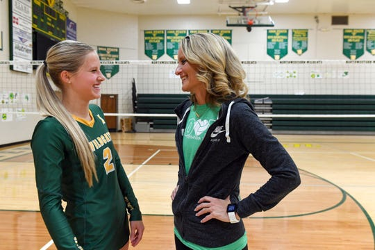 Madalyn Groft and her mother and coach, Nora Groft, chat in the Northwestern High School gymnasium on Thursday, October 31, in Mellette.