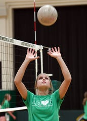Madalyn Groft sets a ball during practice drills in the Northwestern High School gymnasium on Thursday, October 31, in Mellette.