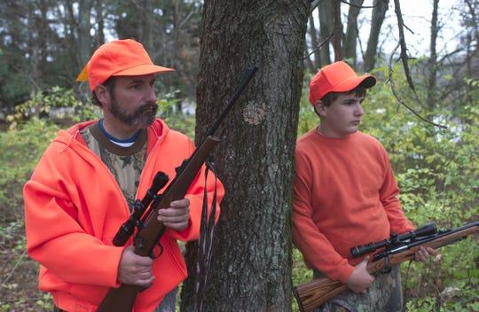 Two hunters looking for deer