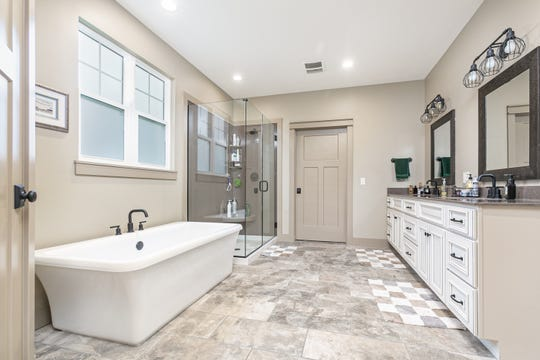 The Hollands' 2-year-old granddaughter is especially fond of the soaking tub, which is large enough for her to swim in. One amenity her grandma especially appreciates is the fact the laundry room is only steps from the closets.