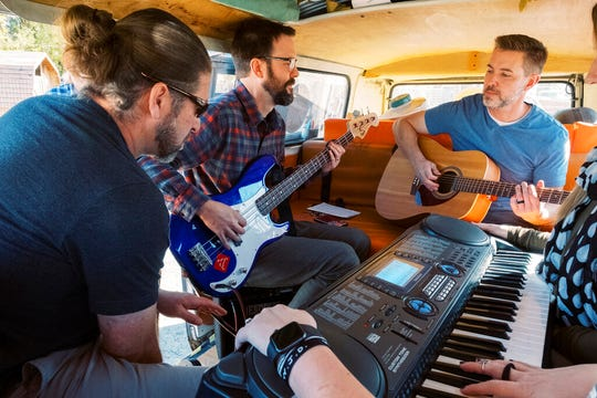 Corey Clayton, Griffin Dean, and Rick Sannar play in the van in the Hee Haw Farms parking lot on Saturday, Oct. 26, 2019, in American Fork, Utah. (Michael Schnell/The Daily Herald via AP)