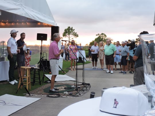 Steve Owen speaks after the Jake Owen Foundation charity golf tournament Friday, Nov. 1, 2019, at Quail Valley Golf Club in Vero Beach. Behind Steve Owen are his sons, country music star Jake Owen (left) and Jarrod Owen.