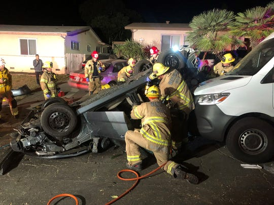 Crews from the Ventura City Fire Department rescued two people trapped in a car on Nov. 4, 2019.