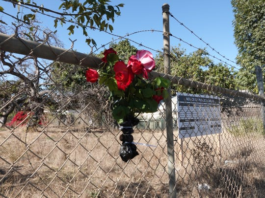 Red roses could be seen Monday attached to a fence on Ventura Avenue , near De Anza Drive, where a 35-year-old man was found dead after an assault early Sunday in Ventura.