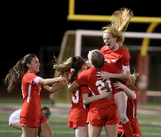 North Rockland celebrates after defeating Mahopac 2-1 in the Section 1 Class AA girls soccer championship at Arlington High School Nov. 3, 2019.