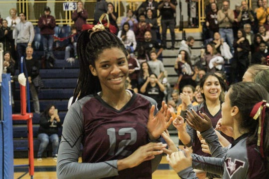 Valhalla Jasmine Grant receives high fives from her teammates as she is introduced in the Section 1 Class C championship game against Rye Neck.