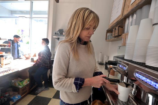 Jane Carroll, owner of Jane Bakes Micro Coffeehouse in Larkin Plaza in Yonkers, makes coffee for a customer Nov. 4, 2019 The coffee house, which opened on Monday, features coffee and homemade baked goods.
