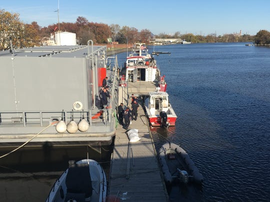 Emergency personnel recovering a body from the Christina River on Nov. 4, 2019.