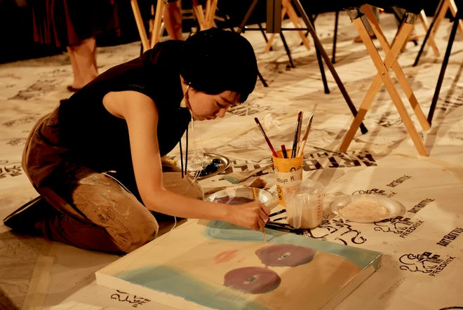 Painter Yasuyo Maruyama will perform a painting demonstration from 5:10 to 5:45 p.m. Saturday before the third Art Battle opens at The Warehouse.