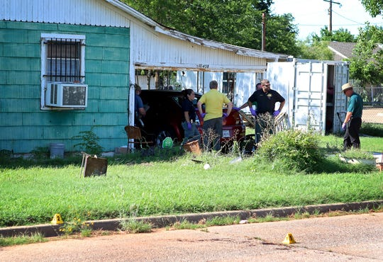 Patrick Johnston/Times Record News Wichita Falls police execute a search warrant in the 400 block of Second Street in June 2016 as part of an investigation into the death of Helen Fletcher, whose body was found in a nearby parking lot.