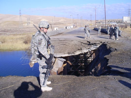 Shawn Monien responds responding to a suicide bombing of a strategic bridge north of Mosul in Iraq in 2008.