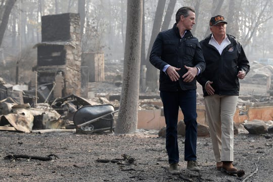 President Donald Trump talks with California Gov. Gavin Newsom during a visit to a neighborhood destroyed by the wildfires in Paradise, California, on Nov. 17, 2018.