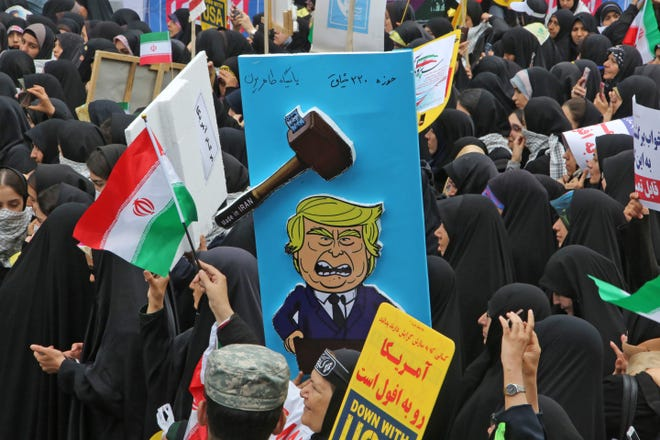 A picture taken on November 4, 2019, shows a placard mocking US president Donald Trump during a rally outside the former US embassy in the Iranian capital Tehran on November 4, 2019, to mark the 40th anniversary of the Iran hostage crisis.