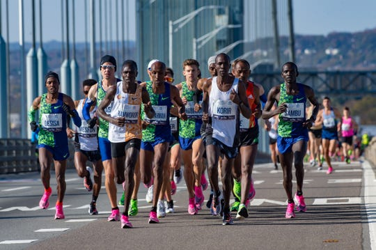 Runners compete in the professional mens division during the 2019 TCS New York City Marathon in New York.