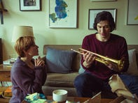 "Nicole (Scarlett Johansson) gifts Charlie (Adam Driver) a trumpet in happier times in ""Marriage Story."""