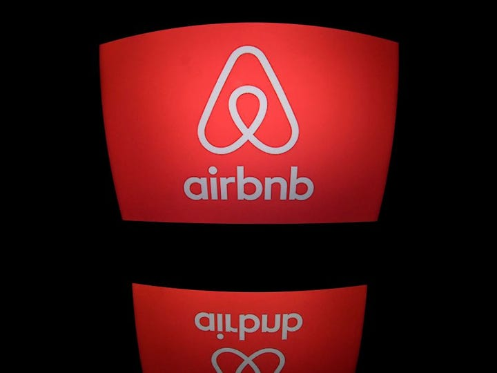 This picture taken on march 2, 2017, shows the logo of online lodging service Airbnb displayed on a computer screen in Paris. (Photo by Lionel BONAVENTURE / AFP)        (Photo credit should read LIONEL BONAVENTURE/AFP via Getty Images)