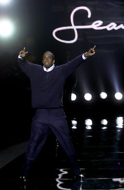 Combs walks down the runway at the end of his Sean John show during Fall 2001 Fashion Week in New York on Feb. 10, 2001.