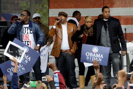Diddy, Kevin Liles, Mary J. Blige, and Jay-Z, perform during a campaign rally for Democratic presidential candidate Sen. Barack Obama in Philadelphia, on Nov. 3, 2008.