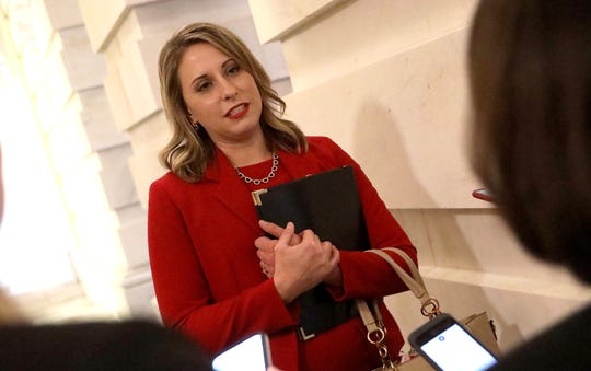 Rep. Katie Hill, D-Calif., answers questions from reporters at the Capitol following her final speech on the floor of the House of Representatives Oct. 31, 2019 in Washington.