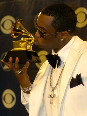 Diddy kisses his Grammy trophy backstage at the 46th Annual Grammy Awards in Los Angeles, Calif. on Feb. 8, 2004.