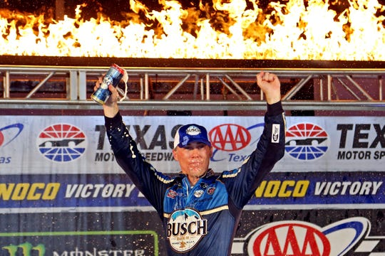 Kevin Harvick celebrates after winning the AAA Texas 500 at Texas Motor Speedway.
