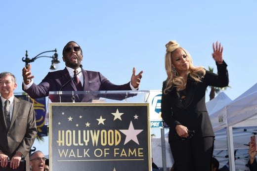 """Diddy leads a chorus of """"Happy Birthday"""" to recording artist Mary J. Blige as she is honored on her birthday with a star on the Hollywood Walk of Fame, Jan. 11, 2018 in Hollywood, Calif."""