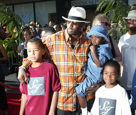 Diddyand his sons pose together at the 2nd annual BET Awards in Hollywood, California on June 25, 2002. Diddy was nominated for two BET Awards that year, and has been nominated for nine in his career. He's also been nominated for 12 BET Hip-Hop Awards in his career.