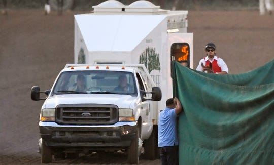 Track workers treat Mongolian Groom after the Breeders' Cup Classic at Santa Anita Park. The horse was later euthanized.