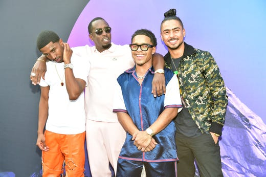 Diddy, who founded the digital television network Revolt, and his sons Christian Combs, Justin Combs and Quincyattend day 3 of REVOLT Summit x AT&T Summit on Sept. 14, 2019 in Atlanta.