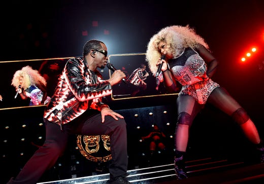 Diddy and Lil' Kim perform onstage during the Bad Boy Family Reunion Tour at The Forum on Oct. 4, 2016 in Inglewood, Calif.