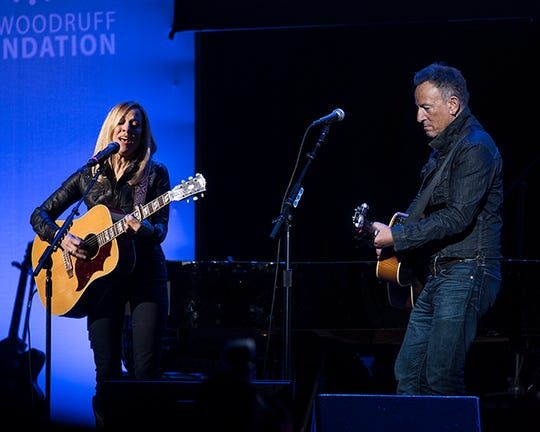 Bruce Springsteen and Sheryl Crow perform at the 13th Annual Stand Up for Heroes event to honor veterans and their families, held at the Hulu Theater at Madison Square Garden in New York City.