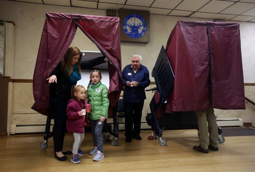 Natalie Wildermuth of Freehold Boro votes with her daughters, Clarissa, 3, and Vivian, 6, on Election Day at the Freehold Elks in Freehold, NJ Tuesday, November 5, 2019.