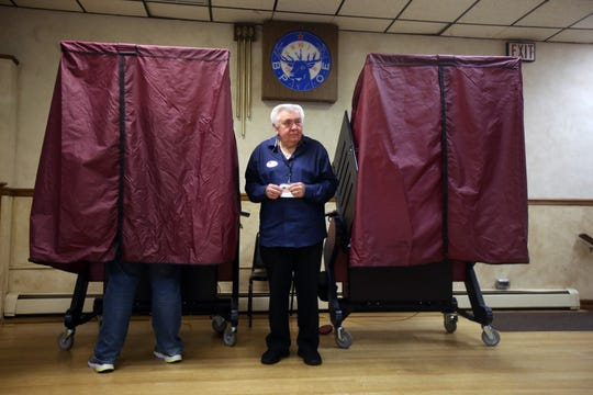 Alan Sobocinski of Freehold Boro, a poll judge, monitors the voting booths on Election Day at the Freehold Elks in Freehold, NJ Tuesday, November 5, 2019.