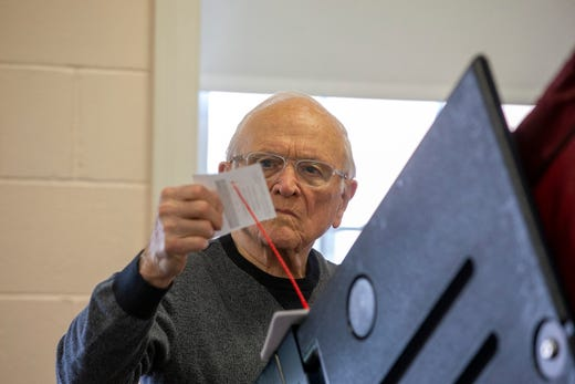 George Thomas of Manchester, a poll worker, collects voters' cards on the voting machines on Election Day at the First United Methodist Church in Toms River, NJ Tuesday, November 5, 2019.