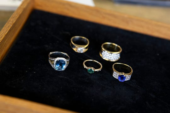 Joel McFadden, owner of The Art of Jewelry, a Red Bank-based business that designs and sells jewelry for its clients, displays some of his work at his business in Red Bank, NJ Tuesday, November 5, 2019.