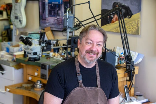 Joel McFadden, owner of The Art of Jewelry, a Red Bank-based business that designs and sells jewelry, poses at his business in Red Bank, NJ Tuesday, November 5, 2019.