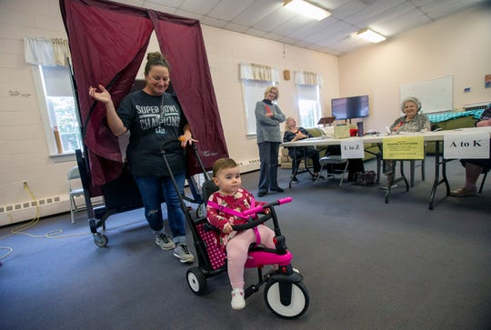 Maria Marino of Toms River votes with her 17-month-old daughter, Isabella, on Election Day at the First United Methodist Church in Toms River, NJ Tuesday, November 5, 2019.