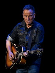 Bruce Springsteen performs during the 13th Annual Stand Up For Heroes event to honor the nation's veterans and their families, held at the Hulu Theater at Madison Square Garden in New York City.