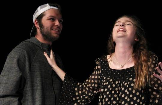 "Rhonda (Cassidy Davis) reacts with pleasure by touching the chest of Tim (Price Payne), who swallowed coffee to prove he is alive in this rehearsal scene from ""This Random World,"" the final fall production by Hardin-Simmons University theater. Nov 4 2019"