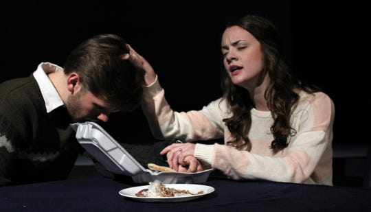 "Claire (Bridgett Mistrot) makes Gary (Trey Smith) pray for those who are starving and would benefit from their leftovers in this rehearsal scene from ""This Random World,"" the final fall production by Hardin-Simmons University theater. Nov 4 2019"