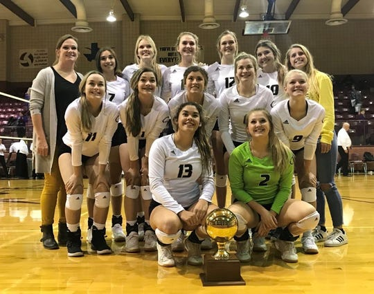 The Clyde volleyball team poses with its bi-district playoff trophy following a sweep of Early on Monday at Bronte High School.