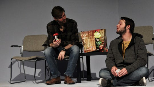 "Gary (Trey Smith, left) and Tim (Price Payne) meet in a hospital waiting area, unaware they both have had a dating relationship with Claire in this rehearsal scene from ""This Random World,"" the final fall production by Hardin-Simmons University theater. They are discussing the enjoyment of Yahtzee. Nov 4 2019"