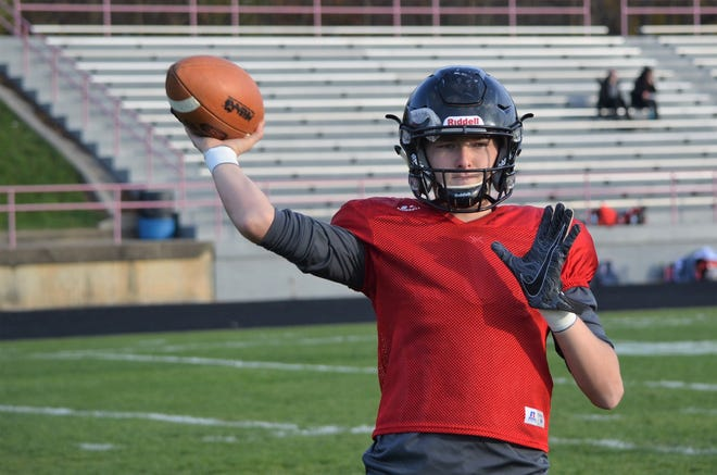 Marshall senior Codey Shellenberger is climbing the record books for single-season touchdown passes as the Redhawks get ready for the second round of the playoffs.