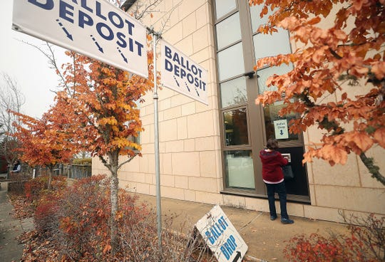 A voter drops their ballot off at Kitsap County Administration Building on Tuesday, November 5, 2019.